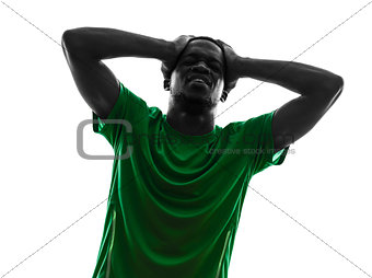 african man soccer player  despair loosing silhouette