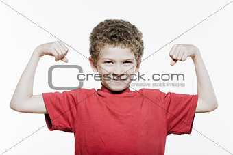 Little boy portrait strong flexing muscle biceps