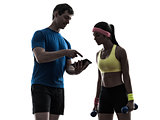 woman exercising fitness  man coach using digital tablet silhoue