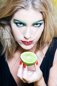 Woman Portrait show a citrus fruit