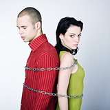 young couple chained