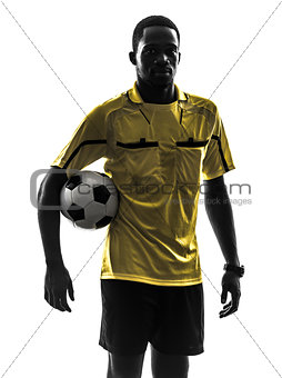 one african man referee standing holding football silhouette