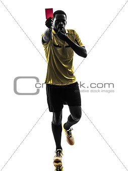 one african man referee standing showing red card  silhouette