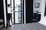 Woman chambermaid cleaning in a hotel bedroom