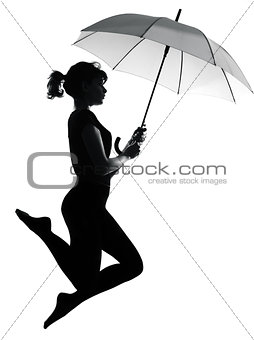 silhouette woman flying  holding open umbrella