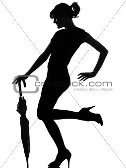 silhouette woman holding closed umbrella