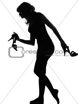 silhouette woman walking quite barefoot on tiptoe