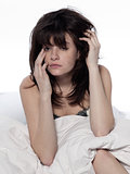 young woman in bed awakening tired insomnia hangover