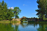 Summer landscape with lake and bridge in Gatchina park,