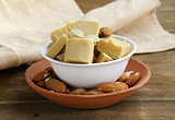 almond paste - marzipan in a bowl with whole nuts