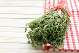 bunch of fresh fragrant  thyme on a wooden background