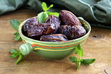sweet dates in bowl on a wooden table