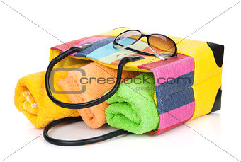 Beach bag with towels and sunglasses