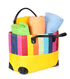 Colorful beach bag with towels