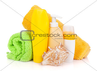 Bath bottles, towel and seashell