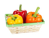 Fresh ripe bell peppers in basket