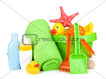 Beach baby toys, towels and bottles