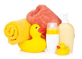 Rubber duck with bath towel and bottles