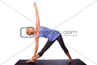 Beautiful woman doing Triangle yoga pose