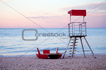 abandoned lifeguard tower and boat