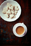 Cup of espresso and heart-shaped biscuits