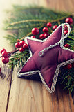 Vintage christmas star on spruce twigs
