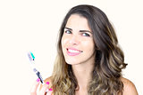 Beautiful young lady holding toothbrush and smiling