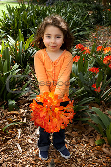 Beautiful little girll with a bunch of clivia from the garden