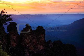 Dawn sunrise silhouettes the Three Sisters Blue Mountains Austra