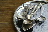 vintage cutlery with old-fashioned napkin on a silver tray