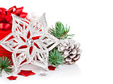 christmas tinsel with branch firtree and red gift