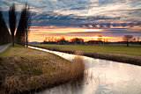 dramatic sunset in Dutch farmland