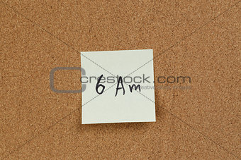 6am reminder note on cork board