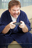 Guy at Home Playing Video Games