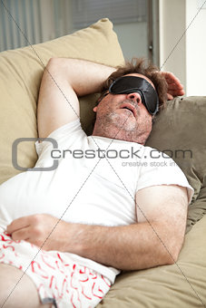 Lazy Man Asleep on Couch