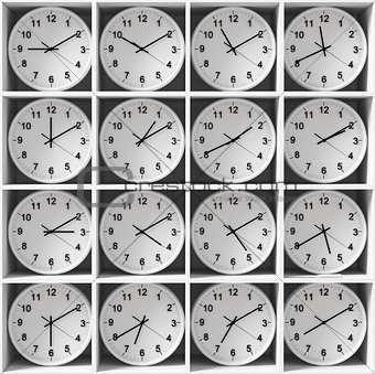 clocks on the white shelves