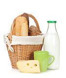 Picnic basket with bread, cheese and milk bottle