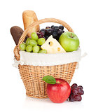 Picnic basket with bread and fruits