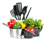 Fresh ripe vegetables, herbs and kitchen utensils