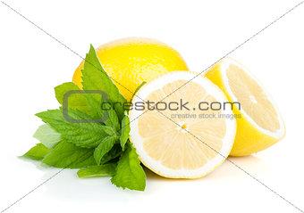 Three ripe lemons and mint