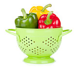 Fresh ripe bell peppers in colander