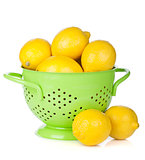 Fresh ripe lemons in colander