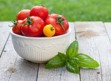 Fresh ripe colorful tomatoes in bowl