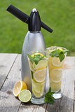 Glasses with homemade lemonade and siphon