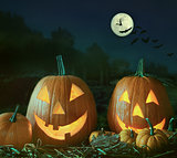 Night scene with Halloween pumpkins and moom