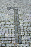 cobbled road with arrow as background