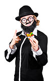 Woman With False Beard And Mustache Holding Cube Puzzle