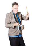 Man Holding Saucepan And Spatula