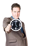 Businessman Showing Clock