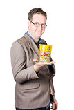 Businessman Holding Popcorn Bucket